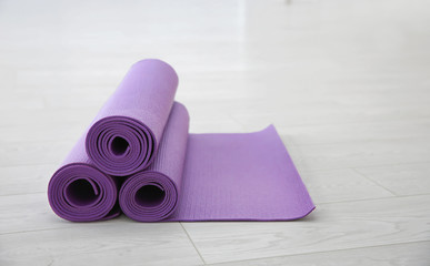Purple yoga mats on light background