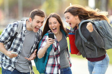 Excited students receiving good news on phone