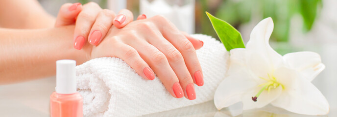 Fotobehang Manicure Manicure concept. Beautiful woman's hands with perfect manicure at beauty salon.