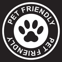 Pet friendly stamp, white isolated on black background, vector illustration.