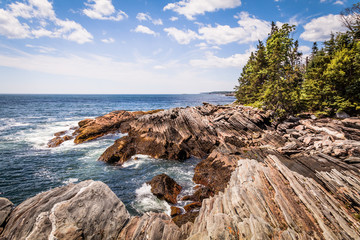 Scenic rocky shoreline in La Verna Preserve in Bristol, Maine, on a beautiful summer day