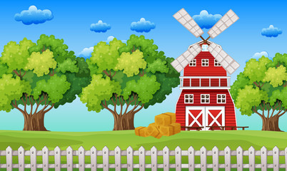 Farm scene with windmill in the field