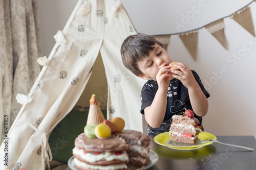 Toddler Boy 3 Year Old Eating Birthday Cake Decorated With Macaroons