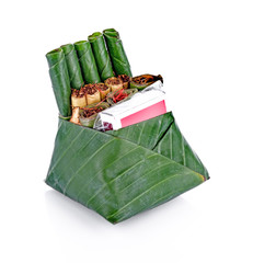 The betel nut match for the ceremony. Wrapped with banana leaves on a white background