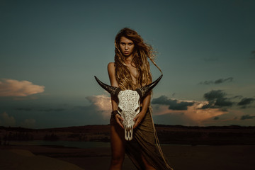 Woman shaman hold cow skull