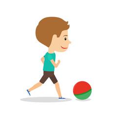 Little boy running with ball