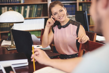 Smiling female working in library