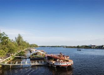 view of river boat restaurants in kampot town cambodia