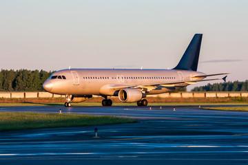 Taxiing passenger aircraft at the early morning
