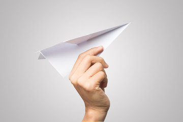 Woman hand Dart Paper Airplane isolated on white background.