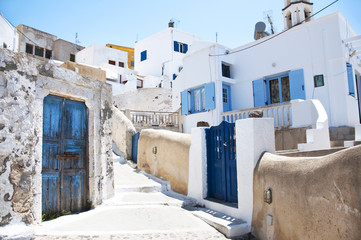 Traditional greek architecture with blue doors in the city of Pyrgos on the island of Santorini, Greece, Europe.