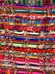 Columns of folded colorful blankets in bolivian street market, La Paz, Bolivia.