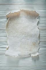 Blank vintage paper sheet on wooden board