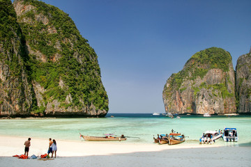 Tourists and longtail boats at Maya Bay on Phi Phi Leh Island, Krabi Province, Thailand