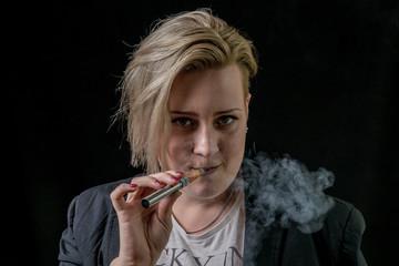 Female vaping vaporizer and facing camera