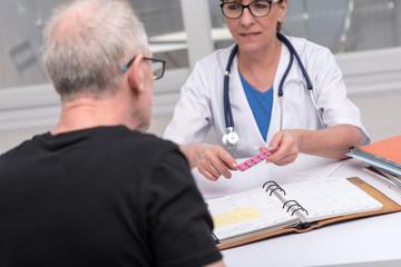 Female doctor explaining medicine to her patient
