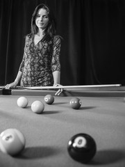 Beautiful woman at the pool table