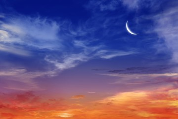 Ramadan background . Red sunset and moon . Mubarak background . Against the background of clouds . beautiful sky .