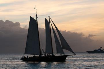 Two masted sailboat, cruising at dusk in Key West harbor.