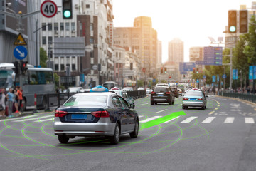 Smart car (HUD) and Autonomous self-driving mode vehicle on metro city road with graphic sensor signal. Wall mural