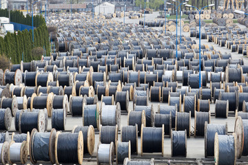 A large stock of coils with wires outdoors