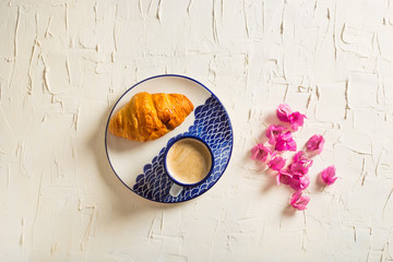 Delicious Croissant and Coffee
