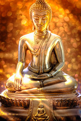 Selective focus of buddha statue with soft lighting effect and glitter abstract background with bokeh defocused lights. Concept of peace, meditation, hope and relaxation