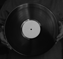 vinyl disk in hands. Close-up. Black and white.