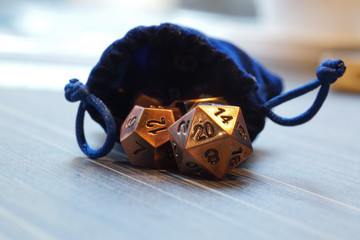 A set of polyhedral dice with a draw string bag