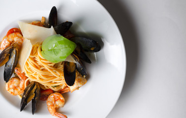Spaghetti with seafood on a white plate