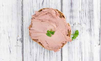 Wooden table with Liverwurst Sandwich (selective focus)