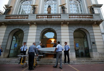 Workers carry a coffin to be used during the exhumation of Spanish artist Salvador Dali in the Teatre-Museu Dali (Theater-Museum Dali) in Figueras city