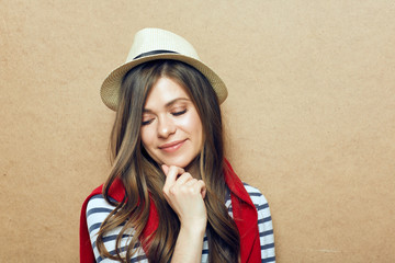 Dreaming girl portrait wearing hipster hat.