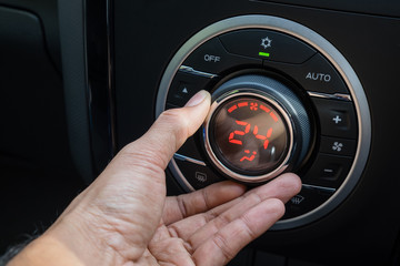 Adjust air conditioner in car , Driver hand tuning temperature control in car air conditioning system