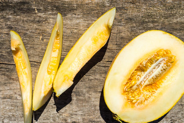 Ripe melon on rustic wooden background