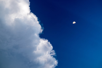 Blue sky with clouds and moon