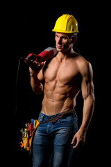 fit shirtless worker with tools