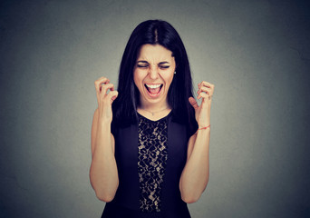 Angry hysterical young woman screaming