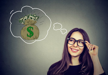 Happy woman dreaming of financial success