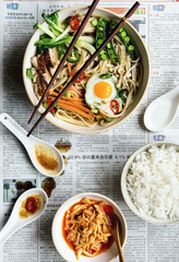 asian noodle soup on newspaper