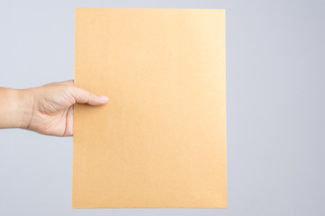 Hand holding a self sealing brown envelope document