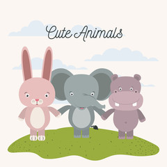 white background with color scene rabbit elephant and hippopotamus cute animals holding hands in grass vector illustration