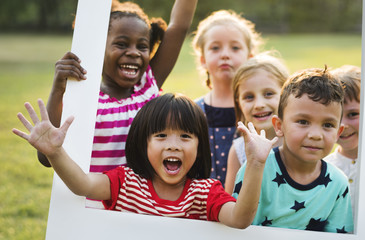 Group of kindergarten kids friends playing playground fun and smiling