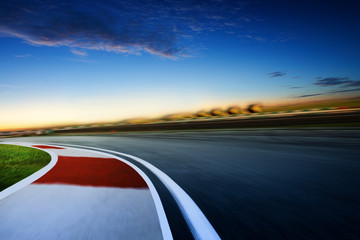 Wall Mural - Motion blurred racetrack ,cold mood , early morning scene .