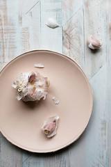 garlic on pink plate