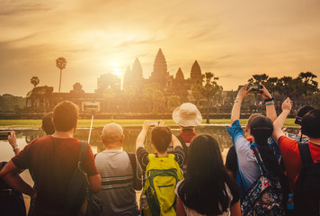 Tourist waiting for see the sunrise over Angkor Wat the largest religious temple in the world, One of the most famous UNESCO world heritage sites of Siem Reap in Cambodia.