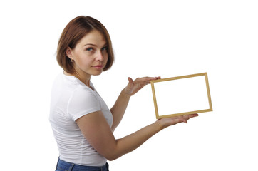 Beautiful girl holds a light wooden frame