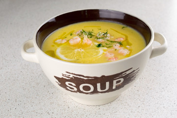 Vegetable soup puree with shrimps and lemon
