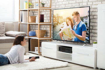 Woman Enjoying Watching Television