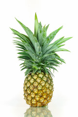 Ripe whole pineapple isolated on white background